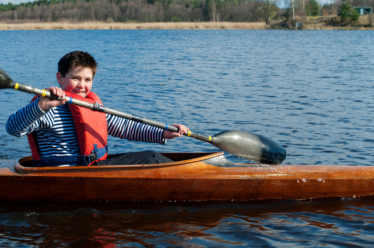 Dollarphotoclub_81755148_The-boy-rowing-in-a-kayak-on-the-river